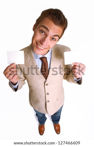 Young businessman holding two white cards.