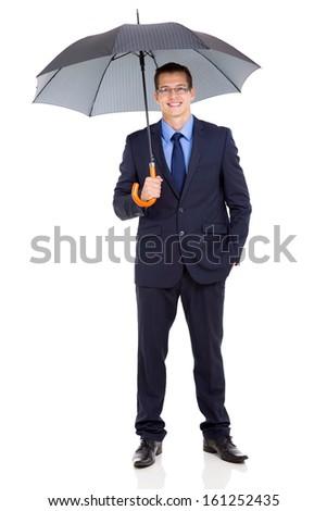 young businessman holding umbrella isolated on white - stock photo
