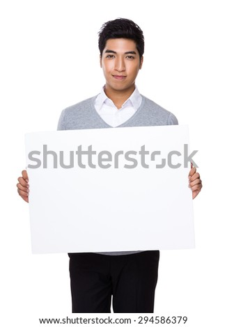 Young businessman holding with placard