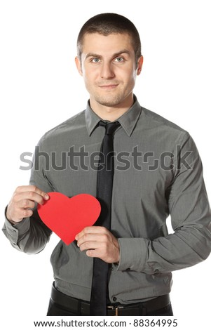 Young  businessman holds a heart shape, isolated on white background - stock photo