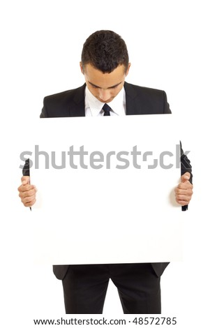 Young businessman holds blank signs. It is isolated on a white background - stock photo