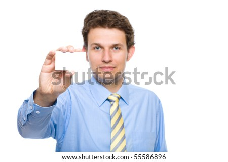young businessman holds businesscard, only card and hand are in focus, face is lightly blurred, studio shoot isolated on white background - stock photo