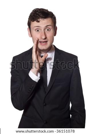 young businessman in a black suit is whispering gossip - stock photo