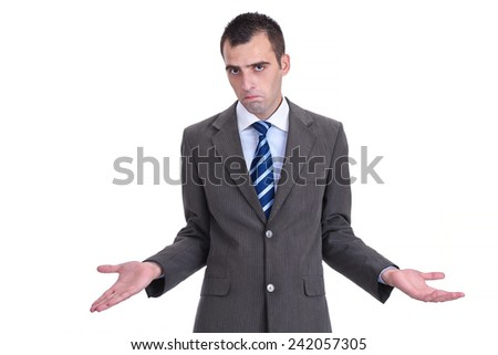 Young  businessman in a gray suit rejecting the responsibility with a shrug and tight lips, isolated on white - stock photo