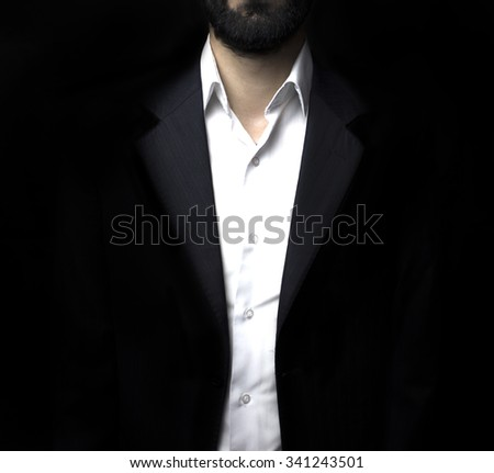 Young businessman in a suit standing - stock photo