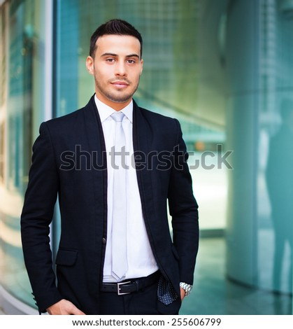 Young businessman in a urban setting - stock photo
