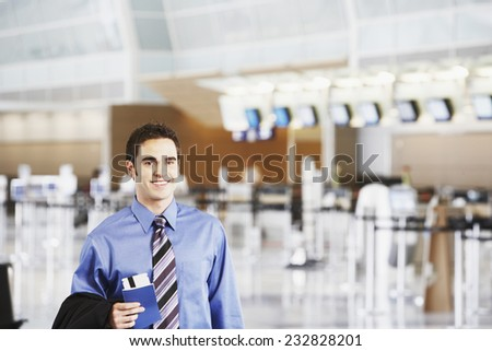 Young Businessman in Airport - stock photo