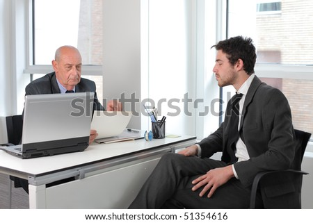 Young businessman in an interview with an older one - stock photo