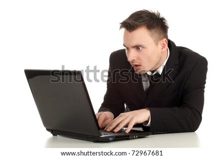 young businessman in black suit working on laptop, series