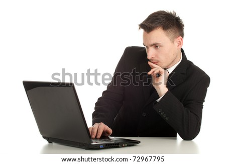 young businessman in black suit working on laptop, series - stock photo