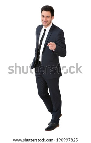 Young businessman in dark suit pointing at camera