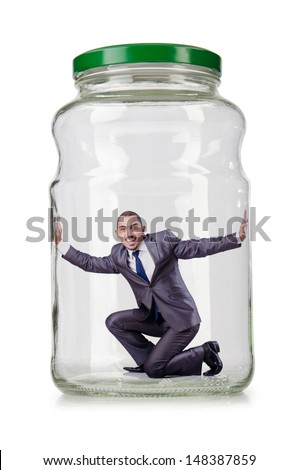 Young businessman in glass jar - stock photo