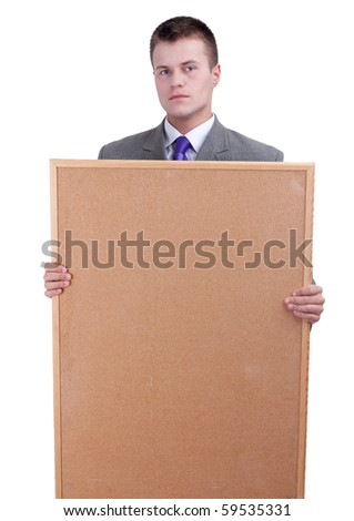 young businessman in grey suit keeping cork board