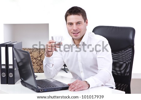 Young businessman in his office