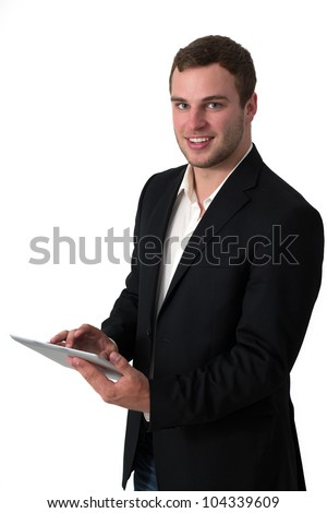 Young Businessman in jeans working on a tablet pc