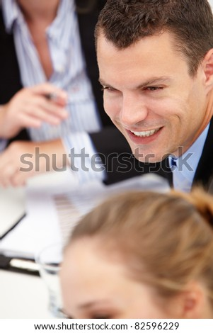 Young businessman in meeting - stock photo