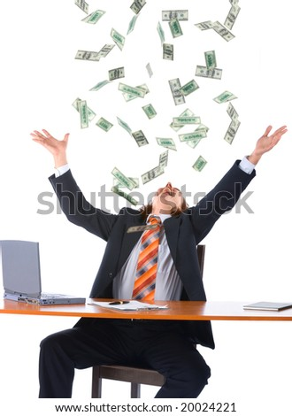 young businessman in office and falling money, isolated on white background - stock photo