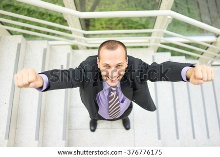 Young businessman in office building - stock photo
