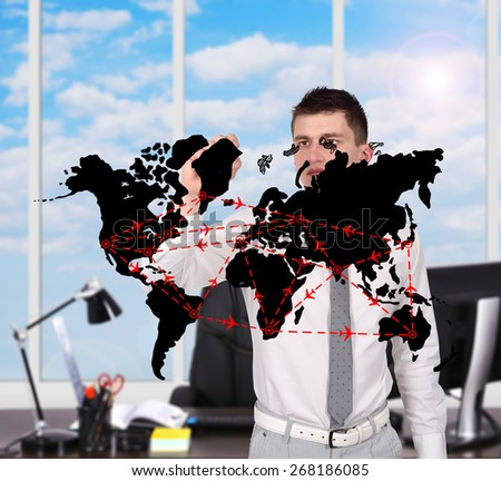 young businessman in office drawing air travel scheme - stock photo