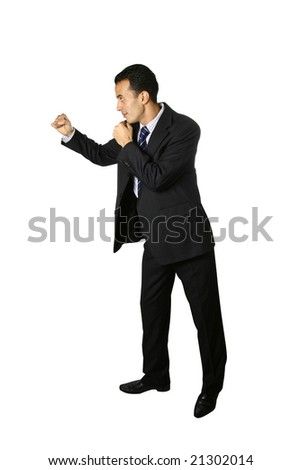 Young businessman in power punch stance, isolated