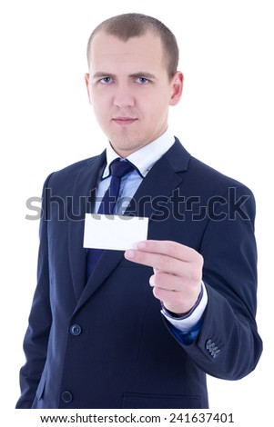 young businessman in suit holding business card isolated on white background - stock photo