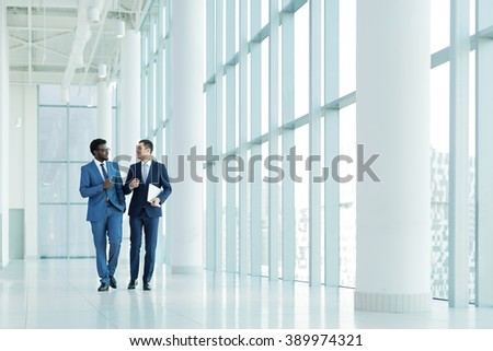 Young businessman in suit in office - stock photo