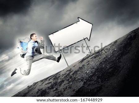 Young businessman in suit running on the road - stock photo