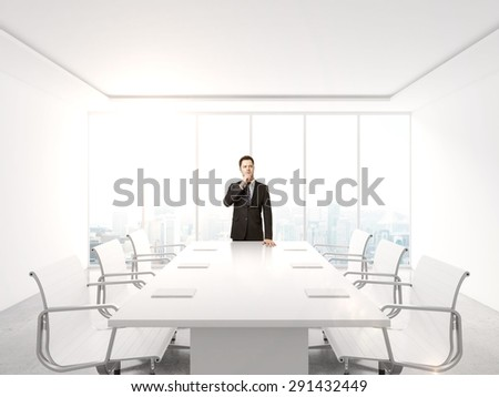 young businessman in suit standing in office - stock photo