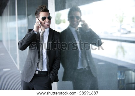 Young businessman in urban background - stock photo