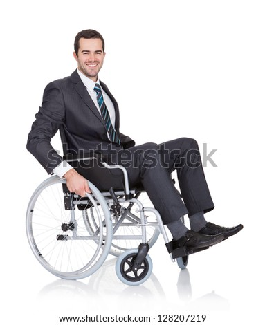 Young businessman in wheelchair. Isolated on white - stock photo
