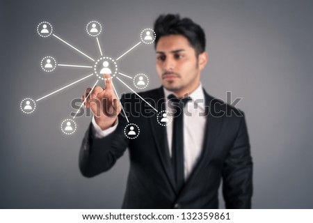 Young businessman indicating social network.