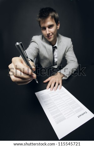 Young businessman inviting you to subscribe a contract - stock photo