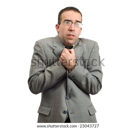 Young businessman is cold from wearing his suit outside, isolated against a white background - stock photo