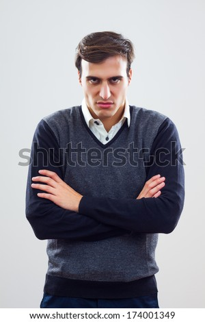 Young businessman is furious because of something,Angry businessman - stock photo