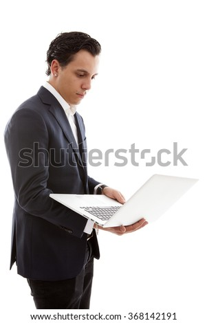 Young businessman is holding laptop over white background