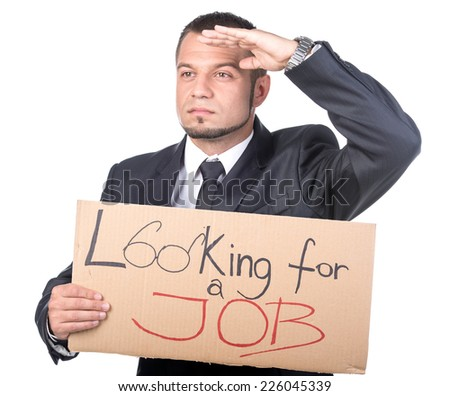 Young businessman is holding sign Looking for a job on the white background. - stock photo