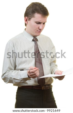 Young businessman is reviewing paper contract. Isolated.