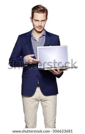 Young businessman is showing something on a computer. Isolated on white background. - stock photo