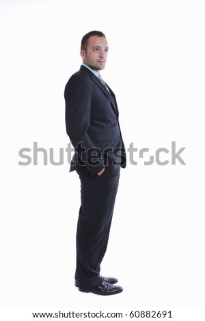 Young businessman is standing, isolated on white - stock photo