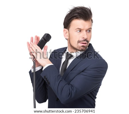 Young businessman is talking on the phone and looks the other way. The human face, expression, emotion, body language. - stock photo