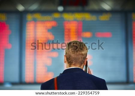 Young businessman is waiting at the airport  - stock photo