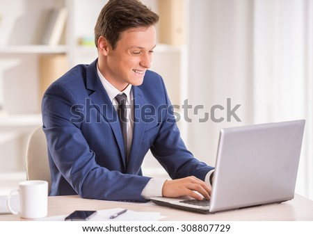 Young businessman is working with laptop in his office.