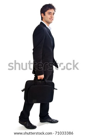 Young businessman isolated on white walking full length - stock photo