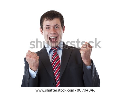 Young businessman jubilates happy with chlenched fists. Isolated on white background. - stock photo