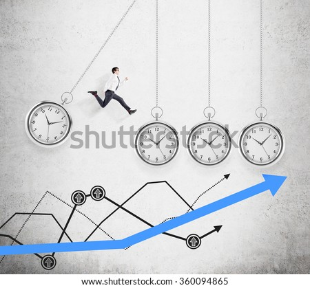 Young businessman jumping from one hovering pocket watch to another, a thick blue graph and several thin black graphs below. Concept of coping with the task.