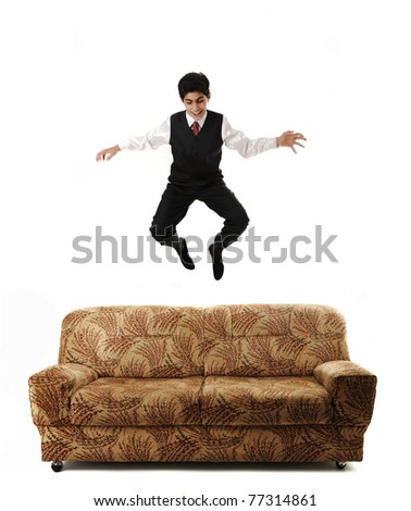Young businessman jumping high on sofa, isolated, conceptual idea