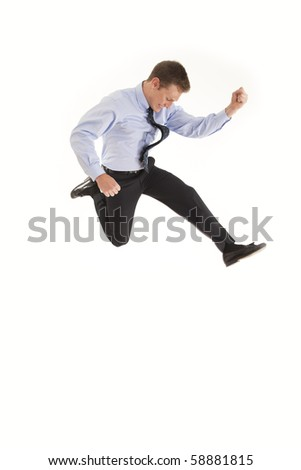 Young businessman jumping in the air with excitement