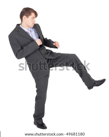 Young businessman kicks as karate, isolated on a white background - stock photo