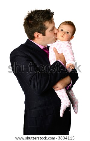 Young businessman kissing and cuddling his baby girl, isolated on white. - stock photo