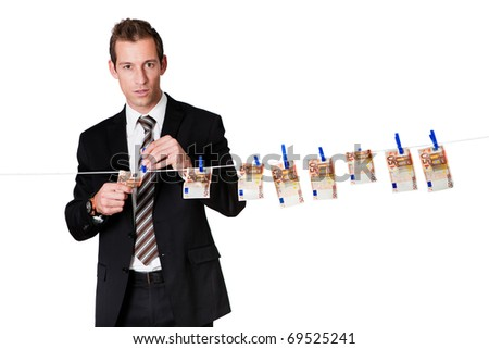 Young businessman laundering money - stock photo